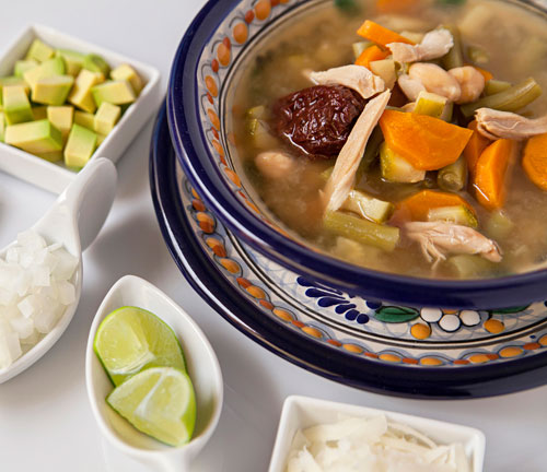 The Tlalpeno Soup accompanied with many ingredients