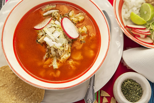 Red Pozole with Chicken accompanied with many ingredients
