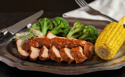 Pork in Adobo served with golden corn and broccoli