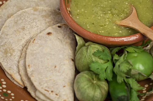 Tomatillo Salsa accompanied with tortillas